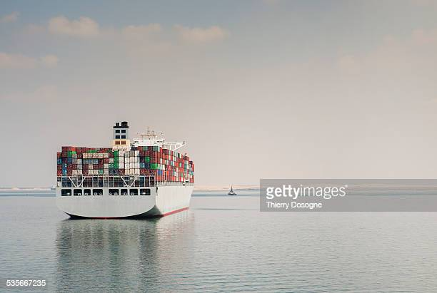 container ship - suez canal stock photos and pictures