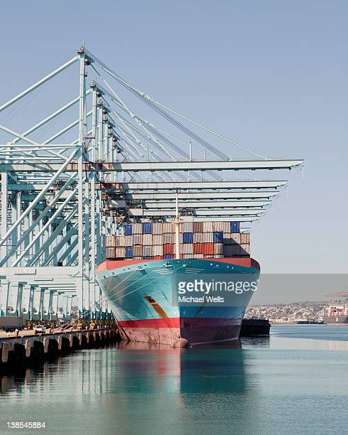 Container ship preparing for unloading at the docks