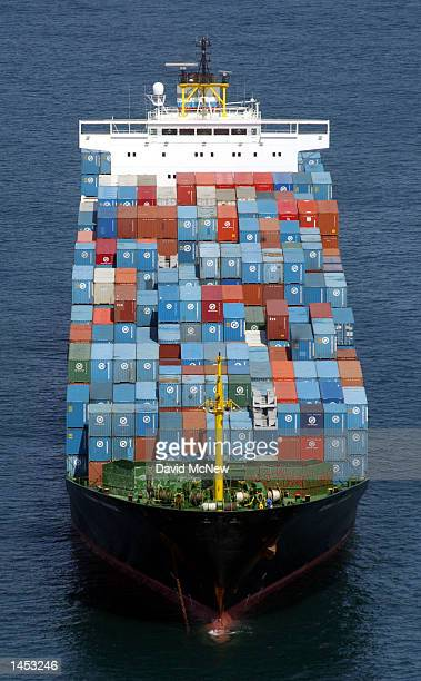 A container ship remains anchored outside of the ports of Los Angeles and Long Beach October 2 2002 in Long Beach California The ship is among the 70...