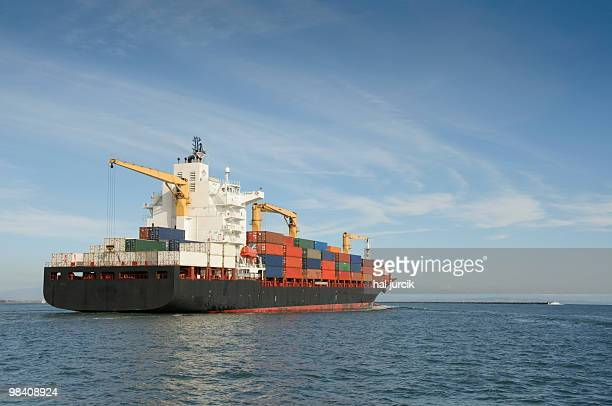 Container ship sailing out to sea