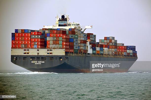 container ship sailing towards hong kong - brand name stock pictures, royalty-free photos & images