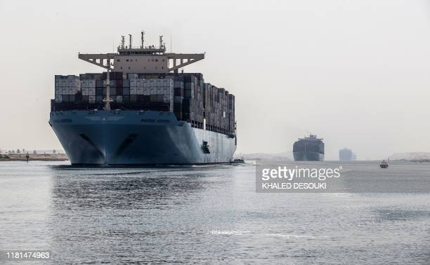 Container ship sails through the new section of the Suez Canal in the Egyptian port city of Ismailia, 135 kms northeast of the caital Cairo on...