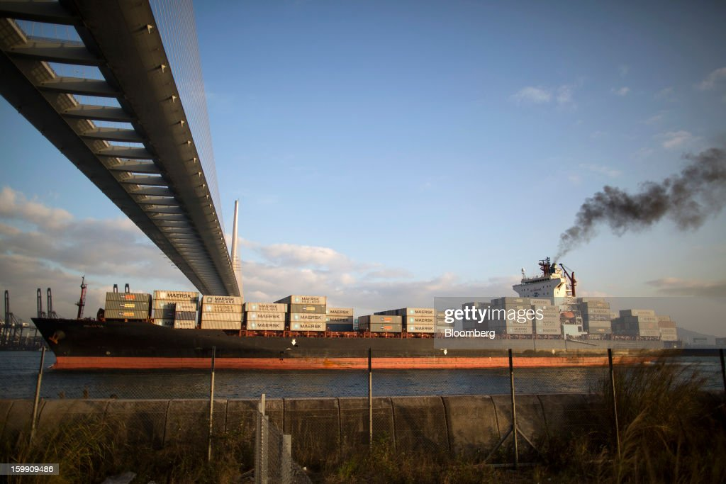 A container ship sails under Stonecutters Bridge in Hong Kong, China, on Monday, Jan. 21, 2013. Hong Kong is scheduled to release export figures for December on Jan. 24. Photographer: Jerome Favre/Bloomberg via Getty Images