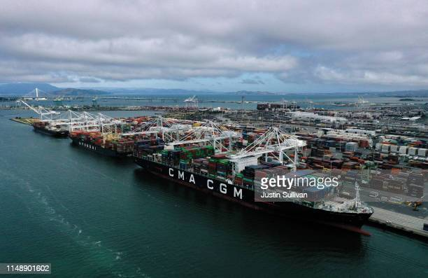 A container ship sits docked at the Port of Oakland on May 13 2019 in Oakland California China retaliated to US President Donald Trump's 25 percent...