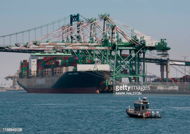 A container ship unloads it's cargo from Asia at the Long Beach port California on August 1 2019 President Donald Trump announced August 1 that he...