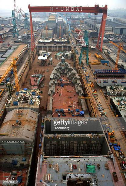 Container ships are built in a drydock at the Hyundai Heavy Industries Co's shipyard in the port of Ulsan South Korea Friday August 11 2006 Hyundai...