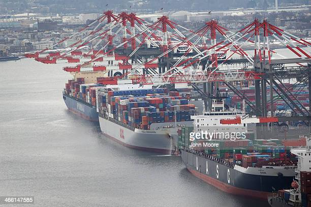 Container ships are docked in port as seen from the window of a Customs and Border Protection Blackhawk helicopter ahead of Super Bowl XLVIII on...