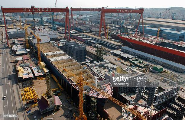 Container ships are under construction in a dry dock at Hyundai Heavy Industries Co's shipyard in Ulsan South Korea in Ulsan South Korea on Wednesday...