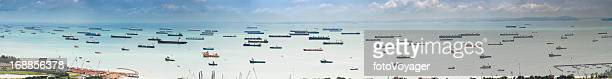 Container ships cargo freighter shipping moored in ocean harbour panorama