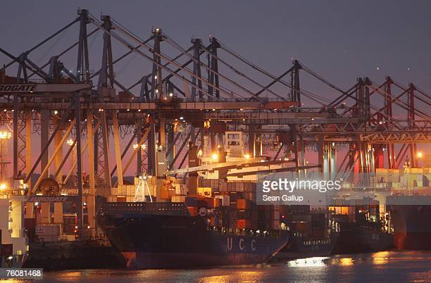 Container ships dock among cranes at the main container port August 13 2007 in Hamburg Germany Northern Germany with its busy ports of Hamburg...