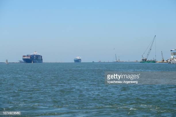 container ships entering the suez canal, port said - port said stock pictures, royalty-free photos & images