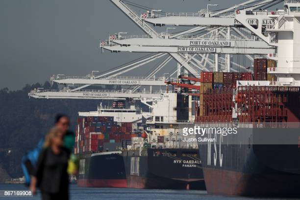 Container ships sit idle at the Port of Oakland on October 27 2017 in Oakland California According to a Commerce Department report the US GDP rose to...
