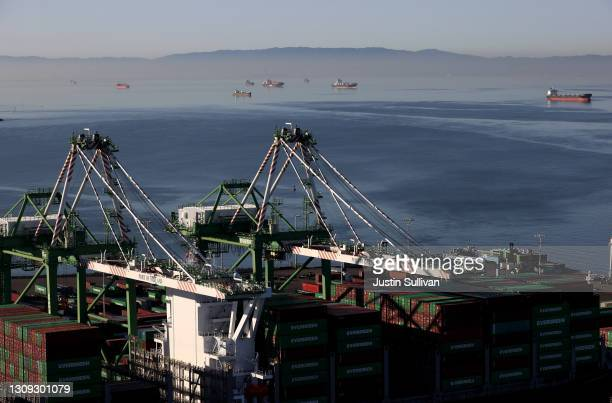 Container ships sit idle in the the San Francisco Bay just outside of the Port of Oakland on March 26, 2021 in Oakland, California. As the global...