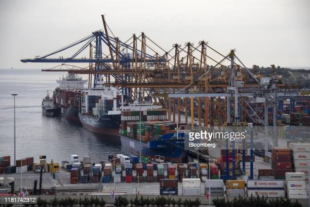 Container ships sit in the docks at the China Ocean Shipping Co. Ltd. Container terminal at Piraeus port, in Athens, Greece, on Monday, Nov. 11,...