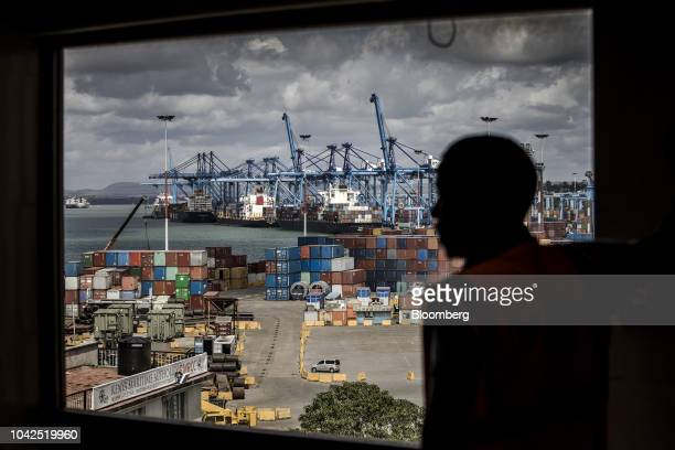 Container ships sit moored dockside by ship-to-shore cranes at Mombasa port, operated by Kenya Ports Authority, in Mombasa, Kenya, on Saturday, Sept....