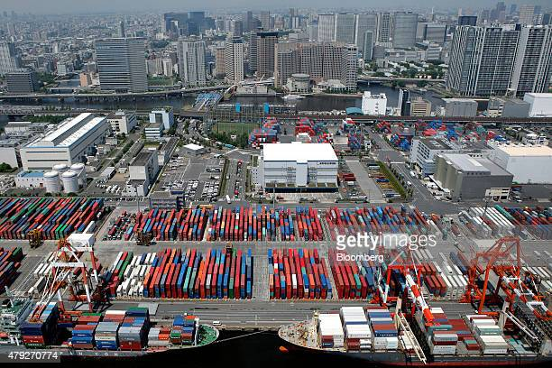 Container ships sit moored while shipping containers are stacked at the Oi Container Terminal in this aerial photograph taken in Tokyo Japan on...