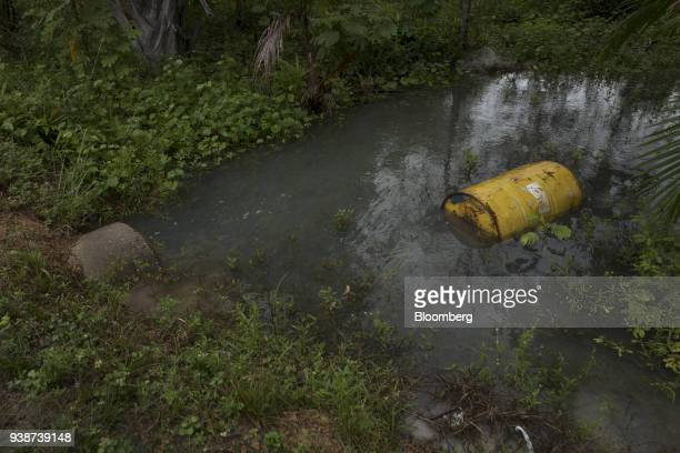 A container sits in a river that allegedly was affected by flooding at the Norsk Hydro ASA alumina refinery in Barcarena Para state Brazil on...