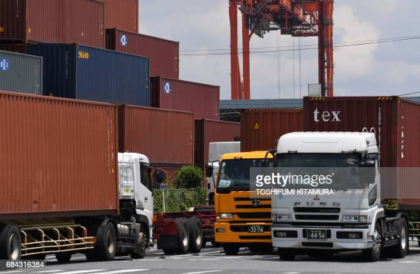 Container tracks jam at Oi container yard of the Tokyo port in Tokyo on May 18 2017 Japan has posted its longest economic expansion in over a decade...