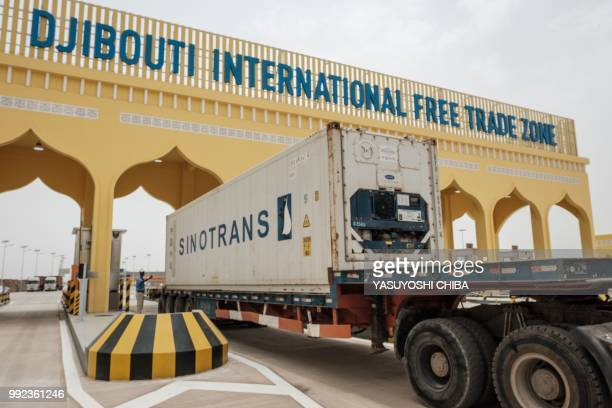 A container truck passes the main gate of Djibouti International Free Trade Zone after the inauguration ceremony in Djibouti on July 5 2018