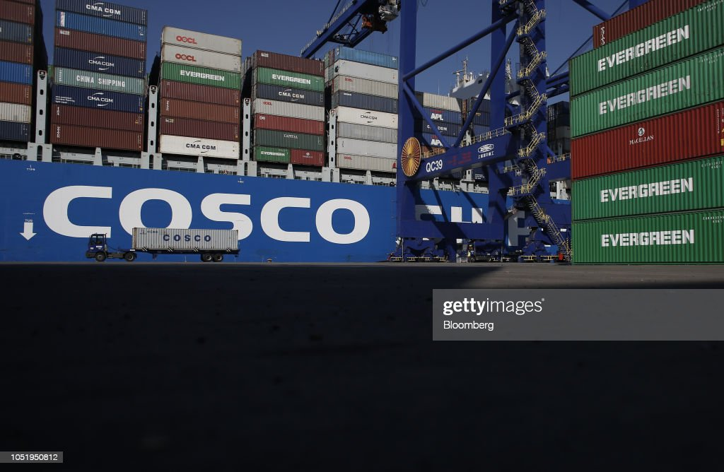 A container truck transports a China Ocean Shipping Group