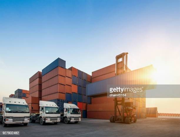 container truck working with loading crane in shipyard for industrial logistic import export. transport industry concept. - shipyard stock pictures, royalty-free photos & images