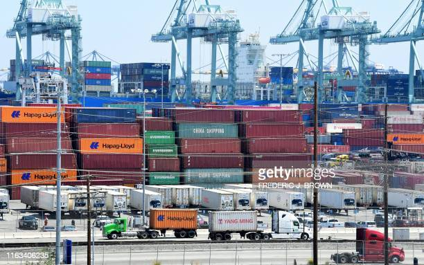 Container trucks arrive at the Port of Long Beach on August 23 2019 in Long Beach California President Donald Trump hit back at China on August 23 in...