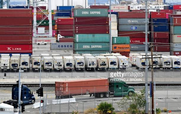 Container trucks arrive at the Port of Los Angeles on June 18 2019 in San Pedro California where the USChina trade war has created logistical havoc...