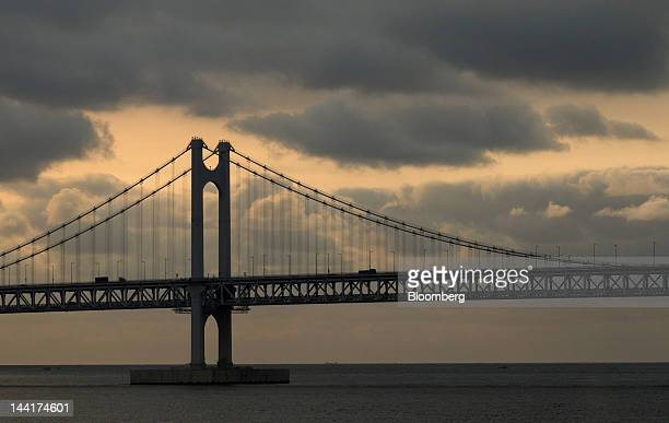 Container trucks drive across the Gwangan Bridge in Busan South Korea on Friday May 11 2012 China and South Korea are starting discussions toward...