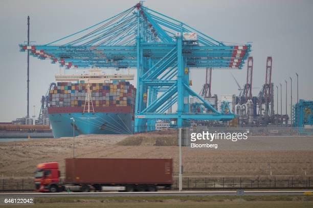 Container vessel Maglebi Maersk operated by AP MollerMaersk A/S sits docked beneath shiptoshore cranes at the RWG container terminal in the Port of...