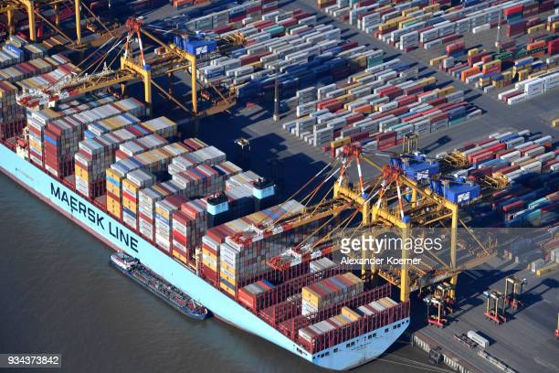 Container vessels stand at Bremerhaven port on March 19 2018 in Bremerhaven Germany The new German government is seeking to prevent new tariffs...