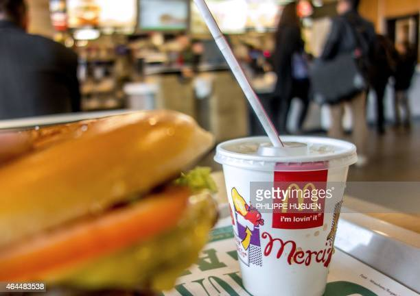 A container with a drink is served at the McDonald's fastfood outlet on February 26 2015 in Lille northern France Several labour unions and a charity...