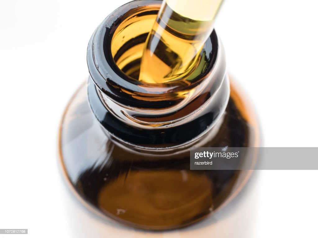 Container with CBD oil, cannabis live resin extraction isolated on white - medical marijuana concept close-up : Stock Photo
