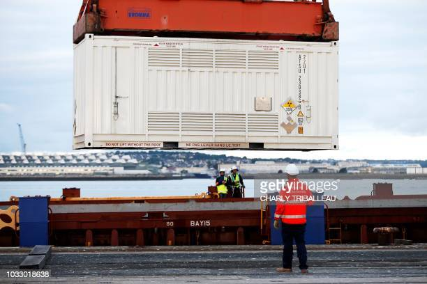 Container with irradiated nuclear fuel from Australia is discharged from the BBC Austria ship, on September 14, 2018 at the port of...