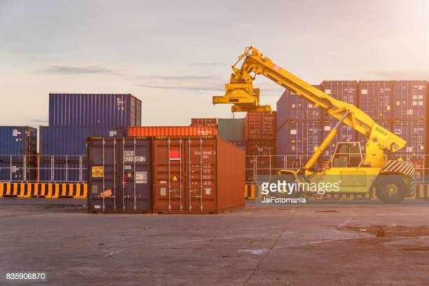 container,container ship in import export and business logistic.By crane ,Trade Port , Shipping.cargo to harbor.Aerial view.Top view.