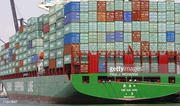Containerized cargo is stacked high on a China Shipping Line freighter as US President George W Bush tours the harbor 31 July 2006 at Miami Beach...