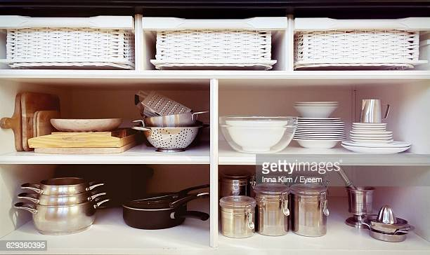 containers and ceramics arranged in shelves at kitchen - neat stock pictures, royalty-free photos & images