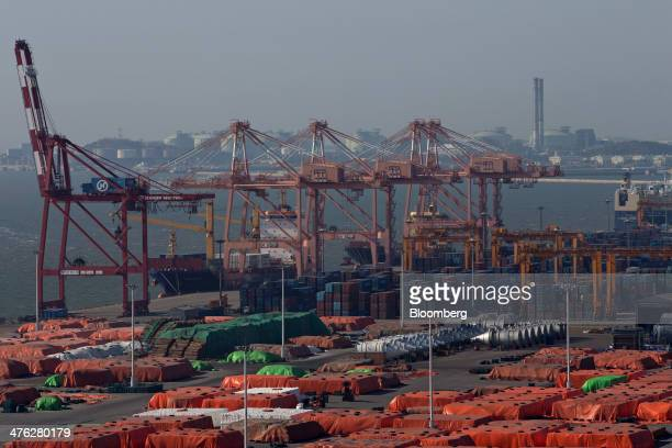 Containers and cranes stand at the Port of Pyeongtaek in Pyeongtaek South Korea on Sunday March 2 2014 South Koreas exports increased 16 percent in...