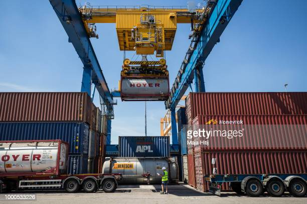 Containers are loaded into the truck in the Duisburg port on July 16 2018 in Duisburg Germany Approximately 25 trains a week use the 'Silk Road'...