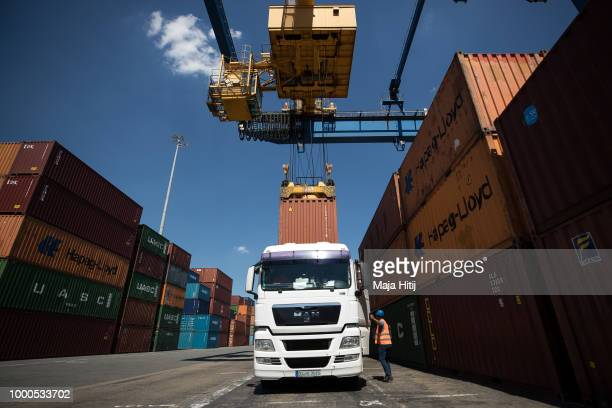 Containers are loaded into truck at terminal in the Duisburg port on July 16 2018 in Duisburg Germany Approximately 25 trains a week use the 'Silk...