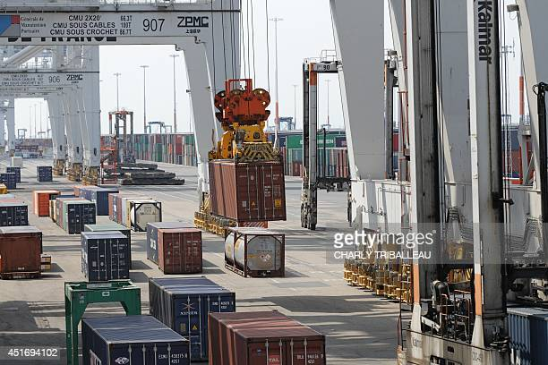 Containers are loaded on July 4 2014 at the port of Le Havre northwestern France AFP PHOTO / CHARLY TRIBALLEAU
