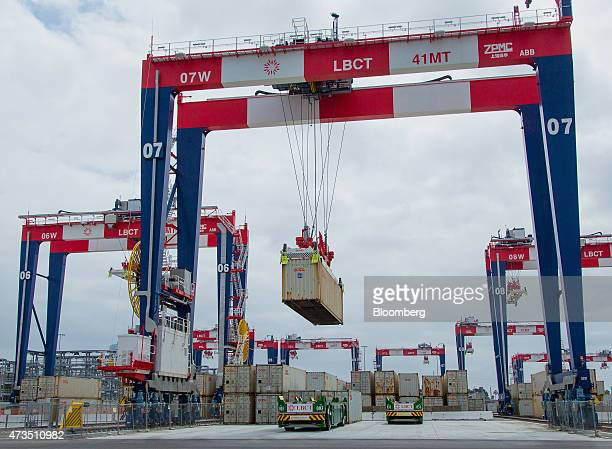 Containers are loaded onto automated guided vehicles during the testing phase of the Long Beach Container Terminal in Middle Harbor at the Port of...