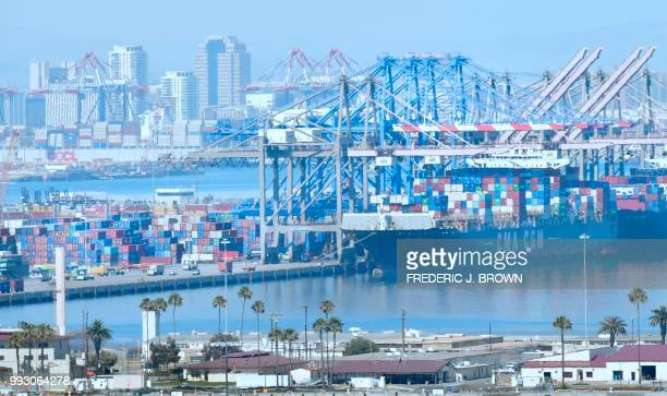 Containers are loaded onto shipping vessels from CMA CGM the French container and transportation company at the Port of Long Beach in Long Beach...