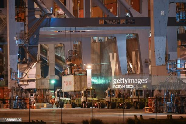 Containers are loaded onto trucks at the Port of Los Angeles, in Los Angeles, California, October 14, 2021. - The Port of Los Angeles and its...