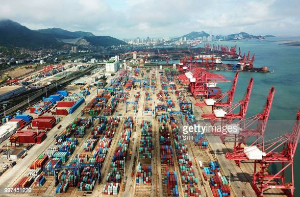 Containers are seen at a port in Lianyungang in China's eastern Jiangsu province on July 13 2018 China's surplus with the United States hit a record...