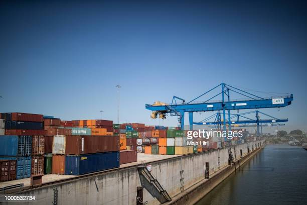Containers are seen at terminals in the Duisburg port on July 16 2018 in Duisburg Germany Approximately 25 trains a week use the Silk Road connection...