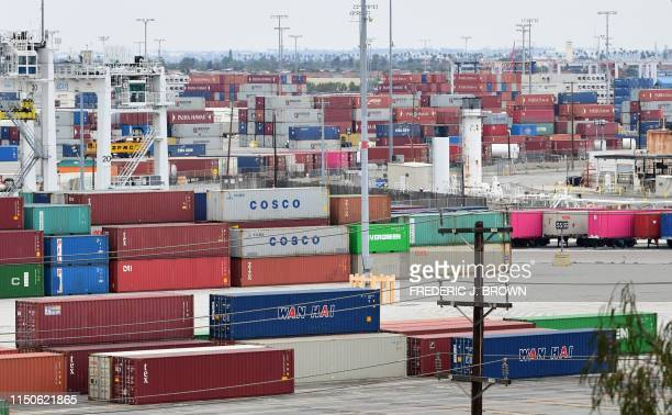 Containers are seen at the Port of Los Angeles on June 18, 2019 in San Pedro, California, where the US-China trade war has created logistical havoc...
