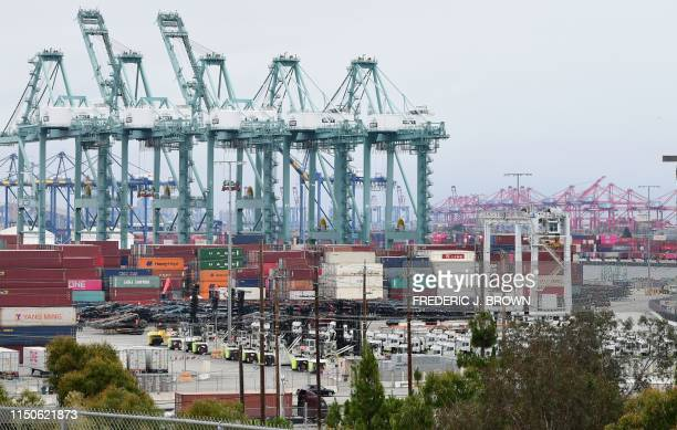 Containers are seen at the Port of Los Angeles on June 18 2019 in San Pedro California where the USChina trade war has created logistical havoc on...