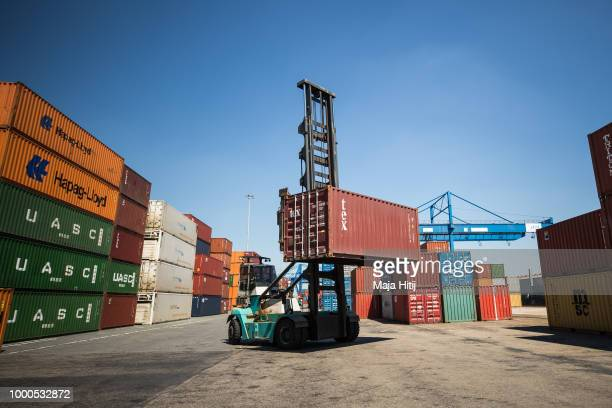 Containers are seen in the Duisburg port on July 16 2018 in Duisburg Germany Approximately 25 trains a week use the Silk Road connection between...