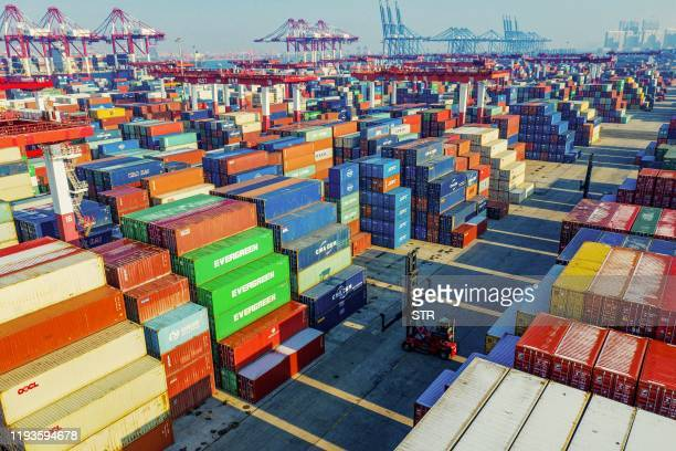 Containers are seen stacked at a port in Qingdao in China's eastern Shandong province on January 14, 2020. - China's trade surplus with the United...