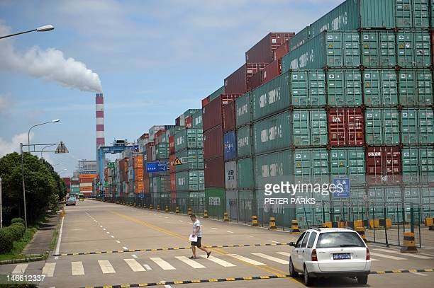 Containers are stacked at the Ningbo Port on June 21 2012 China's manufacturing activity hit a sevenmonth low in June as shrinking exports and weak...